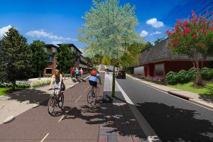 Rendering of bikers going up a bike lane in a mixed use neighborhood